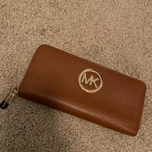 Light brown and gold Michael Kors zip wallet